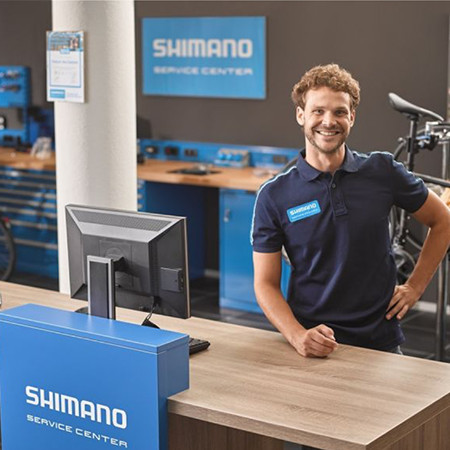 Shimano employee greeting visitors
